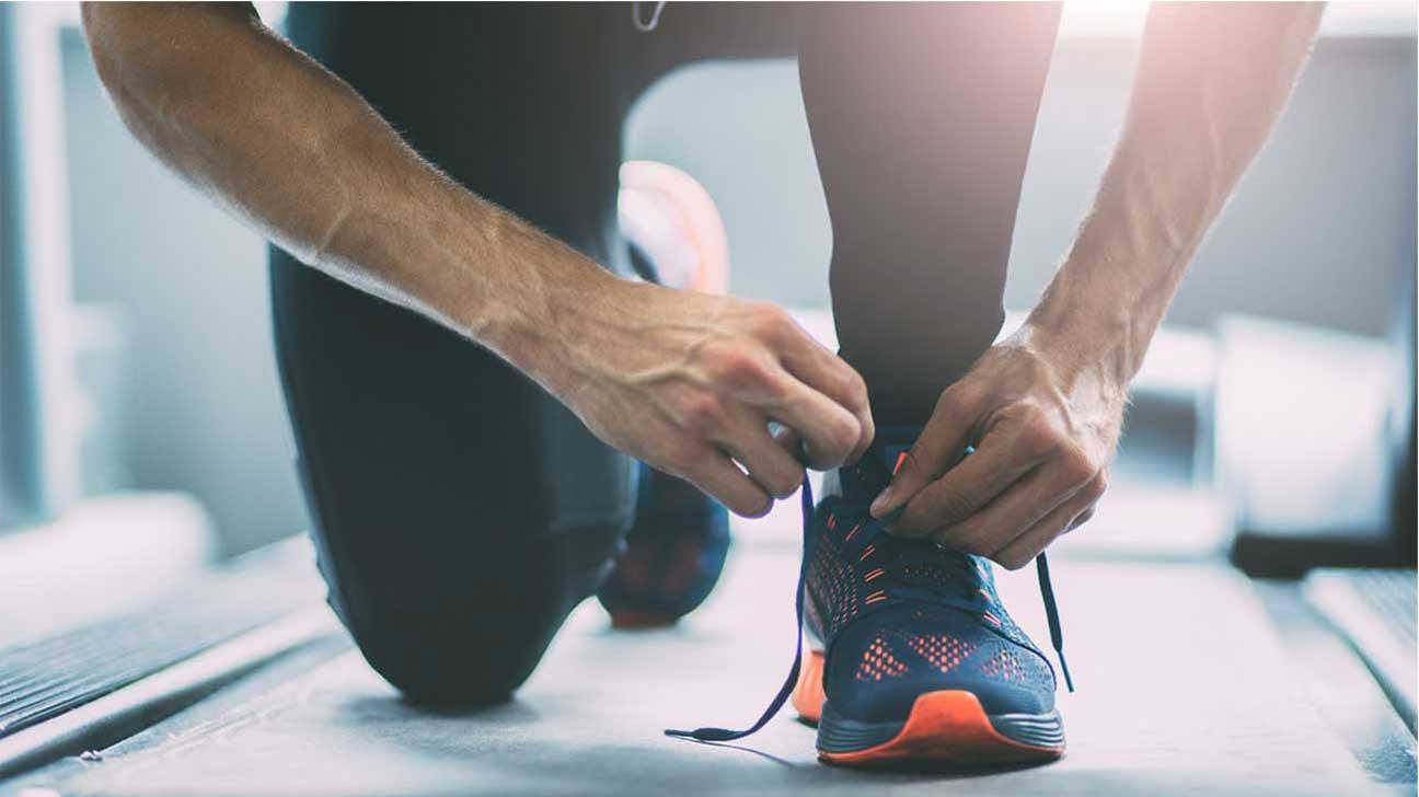 Cardio Burns More Calories Per Session Man Tying Shoelaces