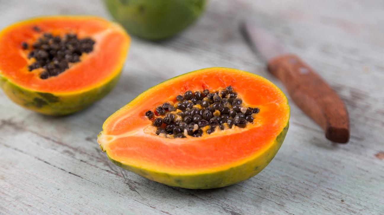 half papaya with seeds