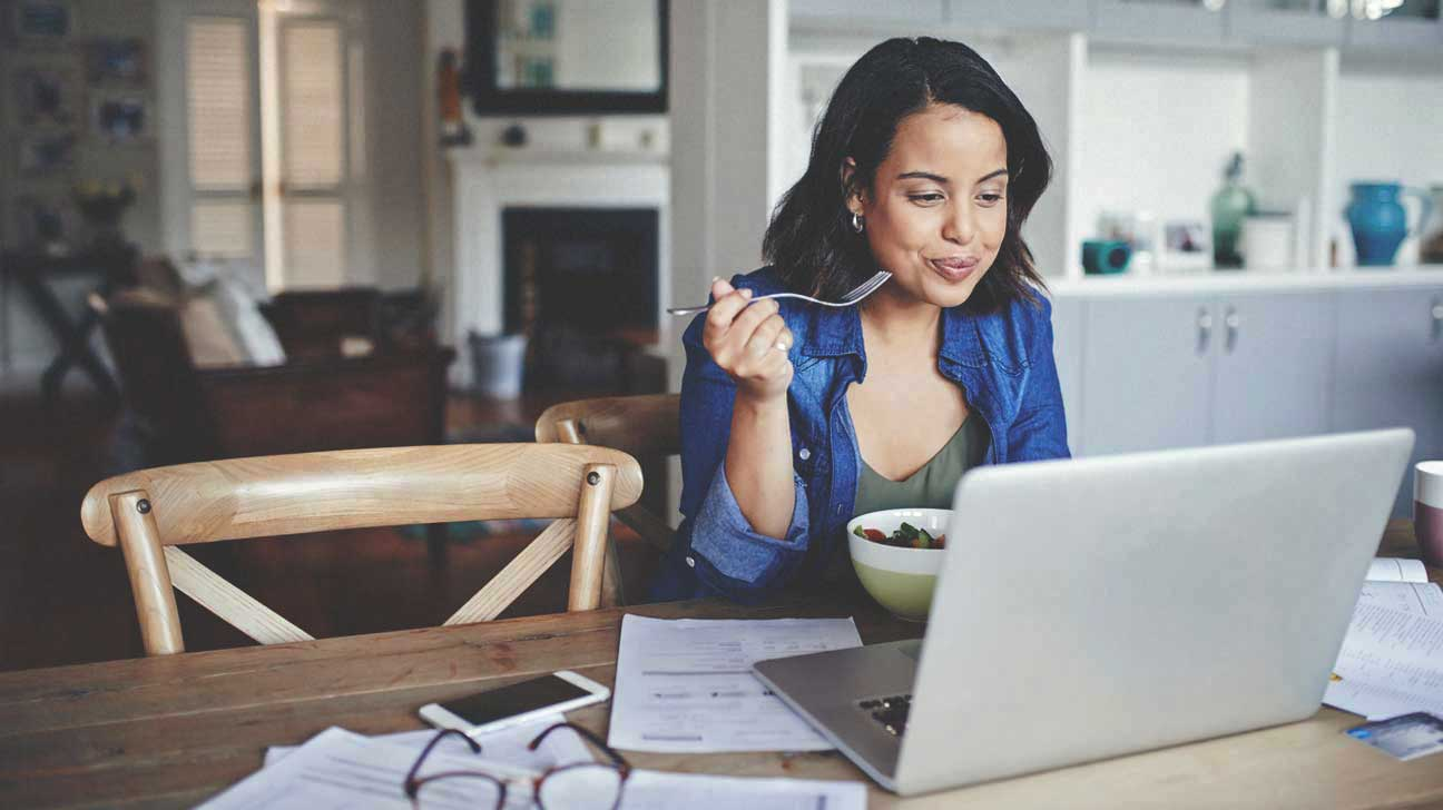 Woman Eating Salad at Home Office