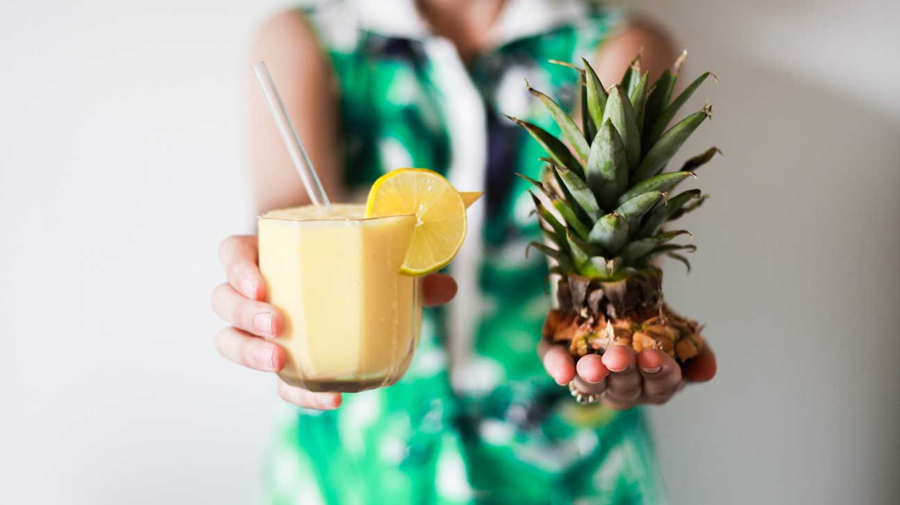 Woman Holding Pineapple Smoothie