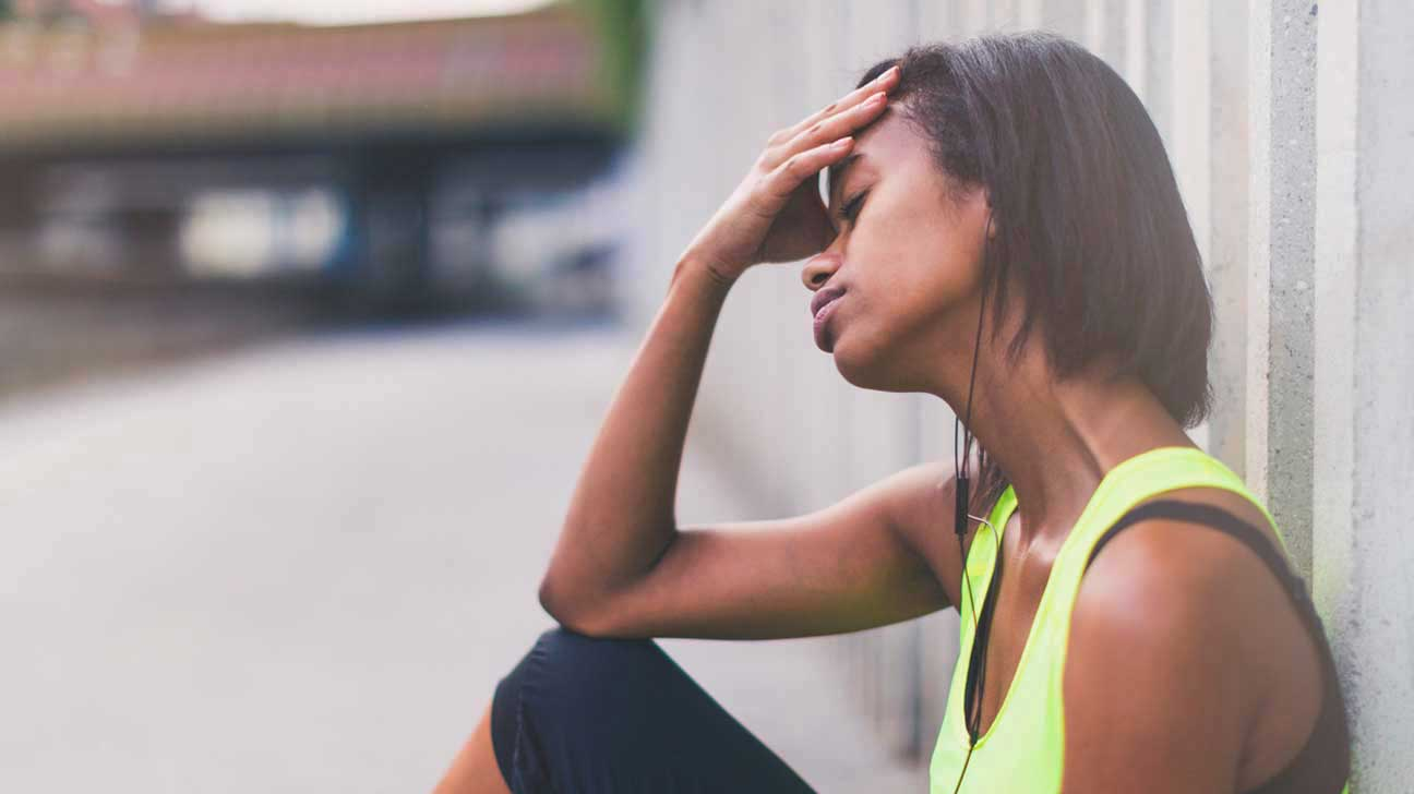 Woman With Headache After Workout