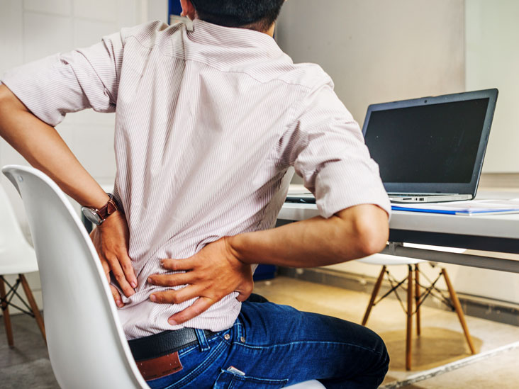 what s causing my back pain and dizziness
