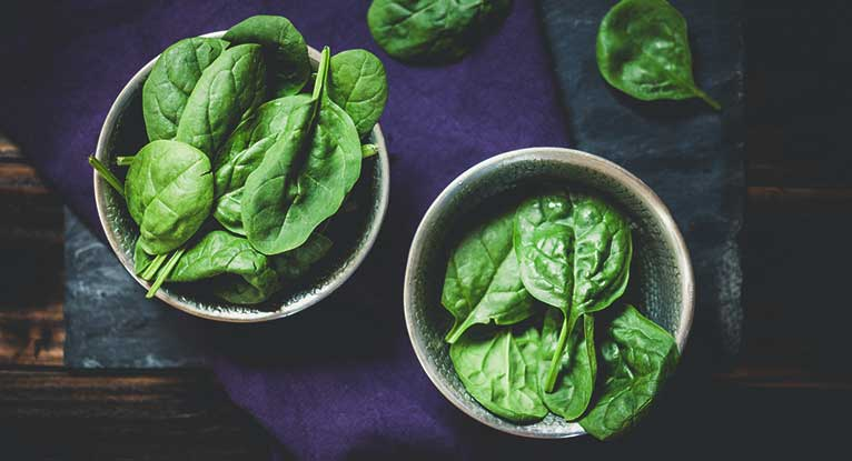 How many calories in 1 oz of spinach