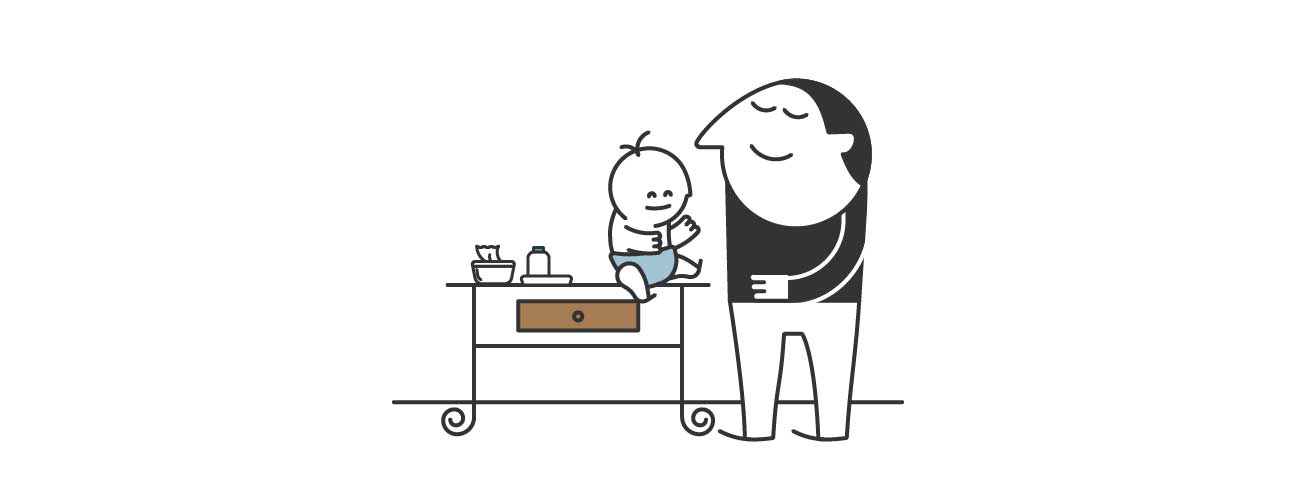 A dad placing baby face up on a changing table